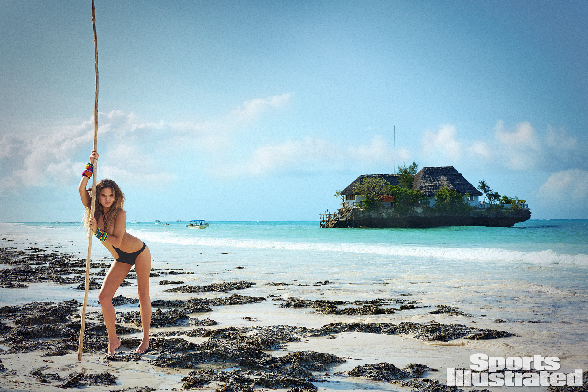 Chrissy Teigen was photographed by Ruven Afanador in Zanzibar. Swimsuit by Iztali Swim.